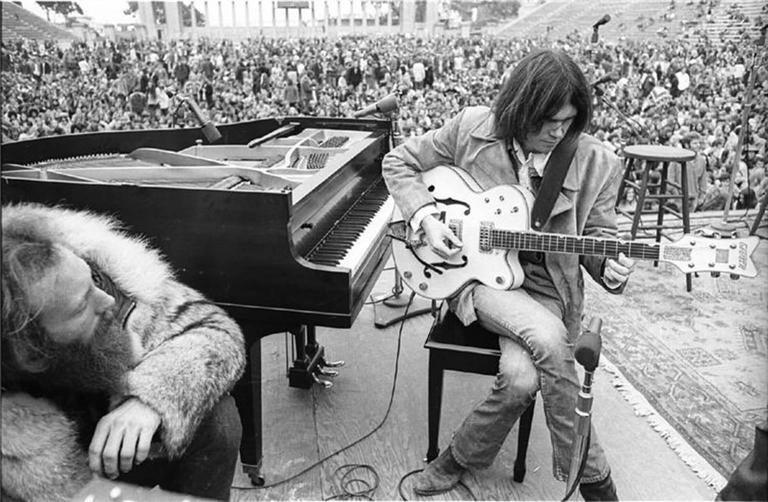 "Henry Diltz Portrait Photograph - Neil Young ""Balboa Stadium"", 1969"