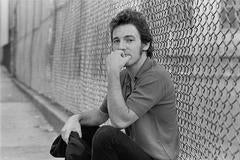 Joel Bernstein - Bruce Springsteen by Schoolyard Fence, NY Aug. 1979