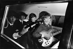 The Beatles in their Limo