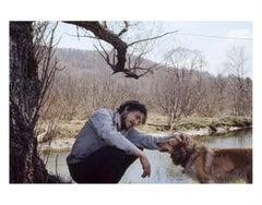 Bob Dylan, Pets Dog Under Tree, 1970