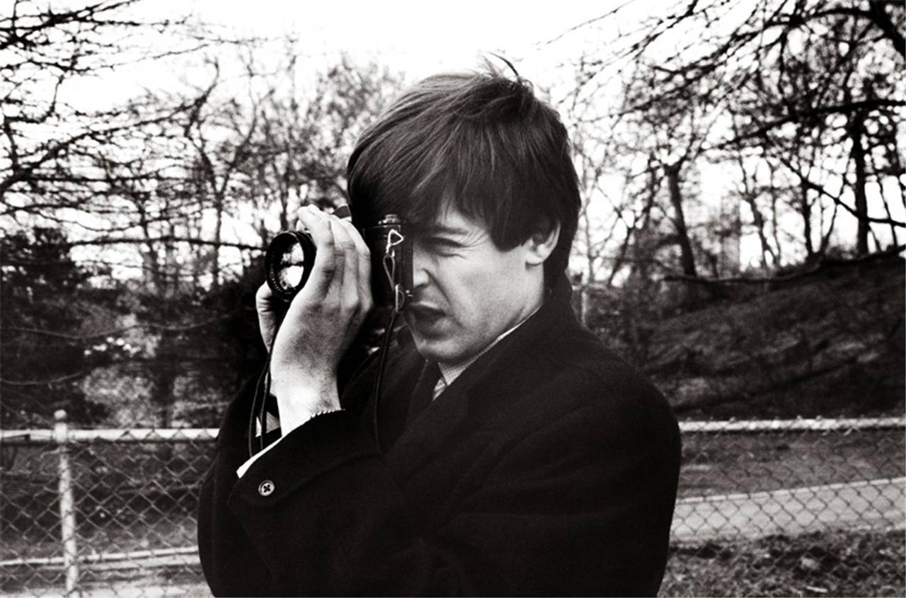 Terry O'Neill Black and White Photograph - Paul McCartney [with camera]