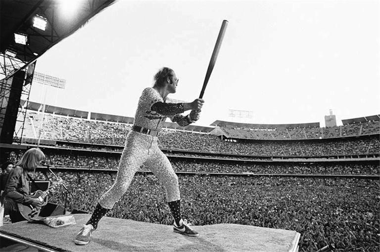 Terry O'Neill - Elton John, Dodgers Stadium, Los Angeles, CA, 1975 1
