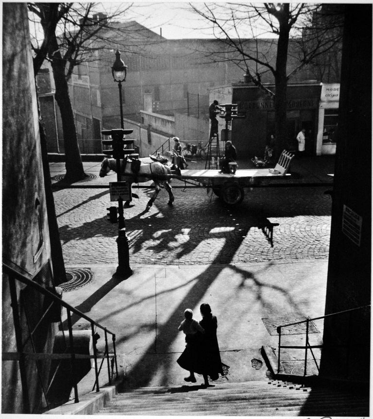 Avenue Simon Bolivar - Willy Ronis, 20th Century, French Humanist Photography - Black Black and White Photograph by Willy Ronis