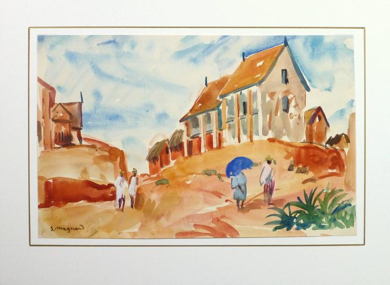 Vivid and bright watercolor landscape of a village perched atop a hillside in Madagascar by French artist Stephane Magnard (1917-2010), circa 1950. Signed lower left.  Stéphane Magnard was the painter for the colonial governor of Madagascar from