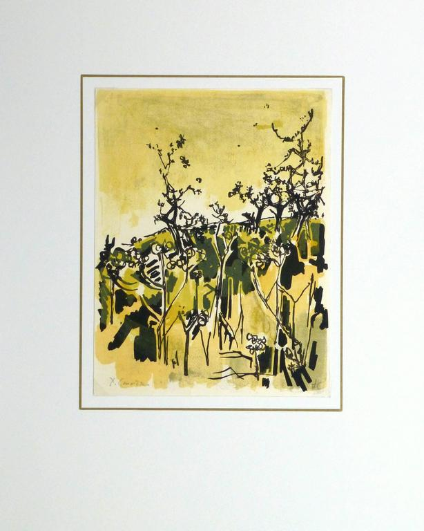 Warmly hued fine art lithograph of a country hillside lush with foliage by French artist Jean Yves Commère, circa 1960. Signed lower left.  Original artwork on paper displayed on a white mat with a gold border. Archival plastic sleeve and