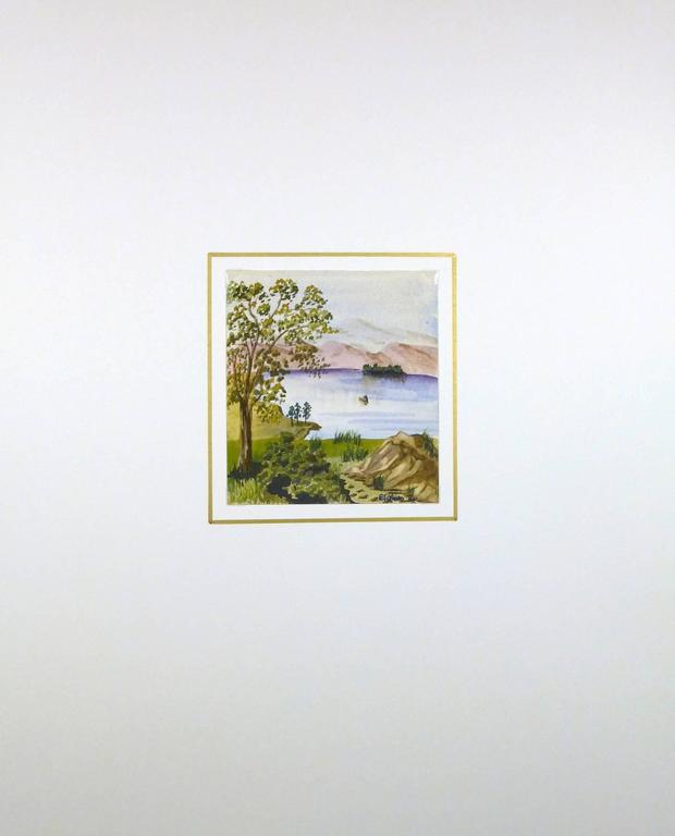 """Peaceful watercolor of lake countryside by English artist EG Bain, 1984. Signed lower right.    Original artwork on paper displayed on a white mat with a gold border. Archival plastic sleeve and Certificate of Authenticity included. Artwork, 5.25""""H"""