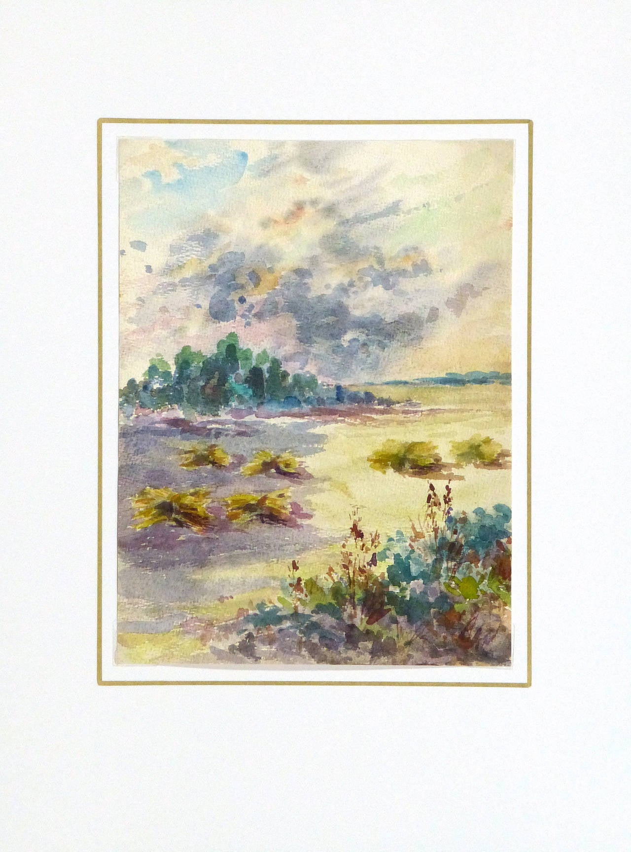 Delightful French watercolor landscape with a sweeping view of a farmer's field by artist Roger Tochon, circa 1930.   Original vintage one-of-a-kind artwork on paper displayed on a white mat with a gold border. Mat fits a standard-size frame.