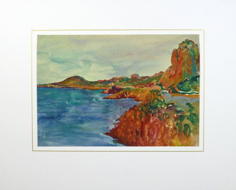 Remarkable and vivid watercolor of the rocky red cliffs of the Esterel overlooking the emerald colored French Riviera coast by French artist Stephane Magnard (1917-2010), 1955.   Original one-of-a-kind artwork on paper displayed on a white mat with