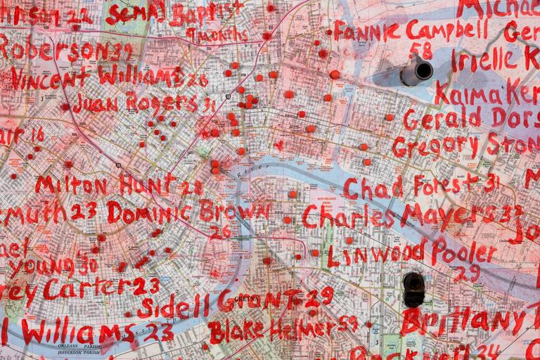 medium: map, gun parts, paint on wood panel