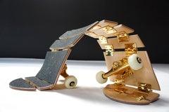Dario Escobar, Sin título, 2016. Sculpture of wood, urethane, gold-plated steel