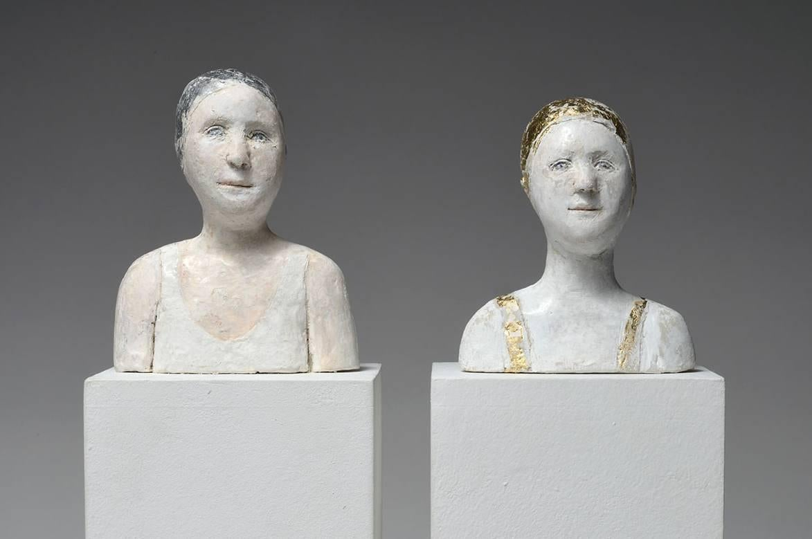 2 small portraits with gold and silver caps