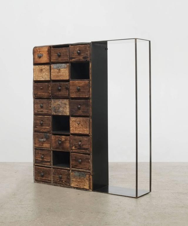Antique chest of drawers fragments and steel.
