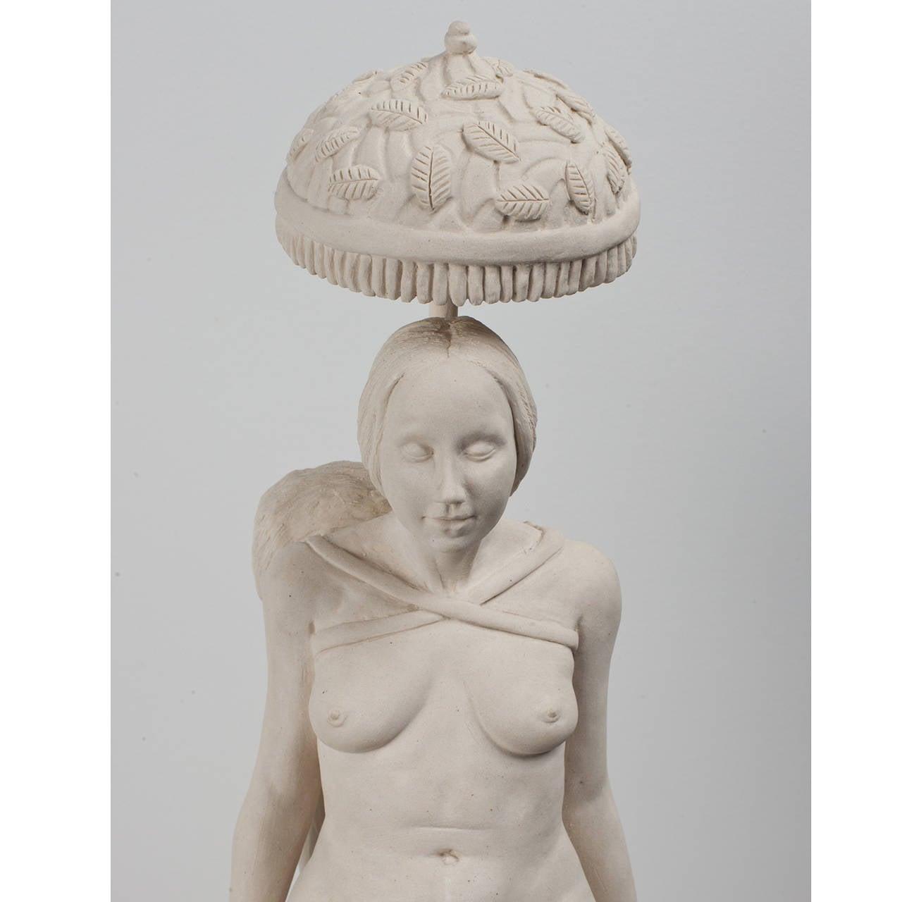 Hand carved porcelain sculpture.