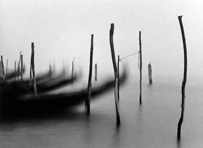 Michael Kenna Black and White Photograph - Gondolas I, Venice, Italy, 1980
