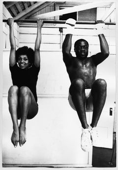 Lola Falana in the gym doing pull-ups photographed by Frank Dandridge, 1969.