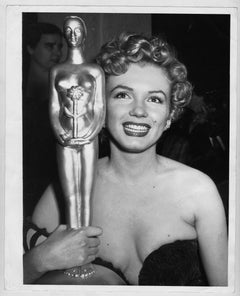 Actress Marilyn Monroe wins a trophy, 1952. Photographed by Earl Leaf