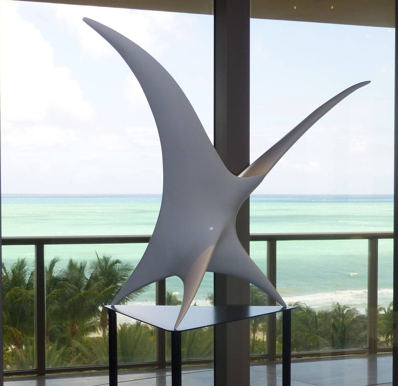"""Twin Bird is a resin sculpture made by Patrice Breteau, a French contemporary artist. This piece is available in eight different colors, all resistant to UV exposure and outdoor weather.  This sculpture """"Twin Bird"""" refers to the two"""