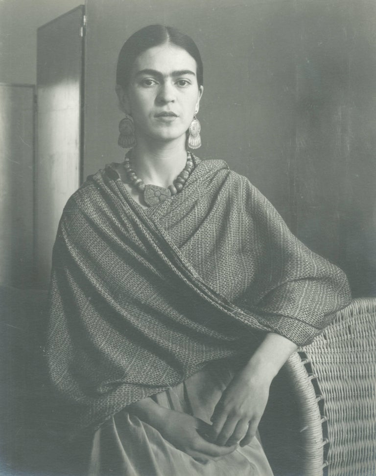 Frida (standing by basket)