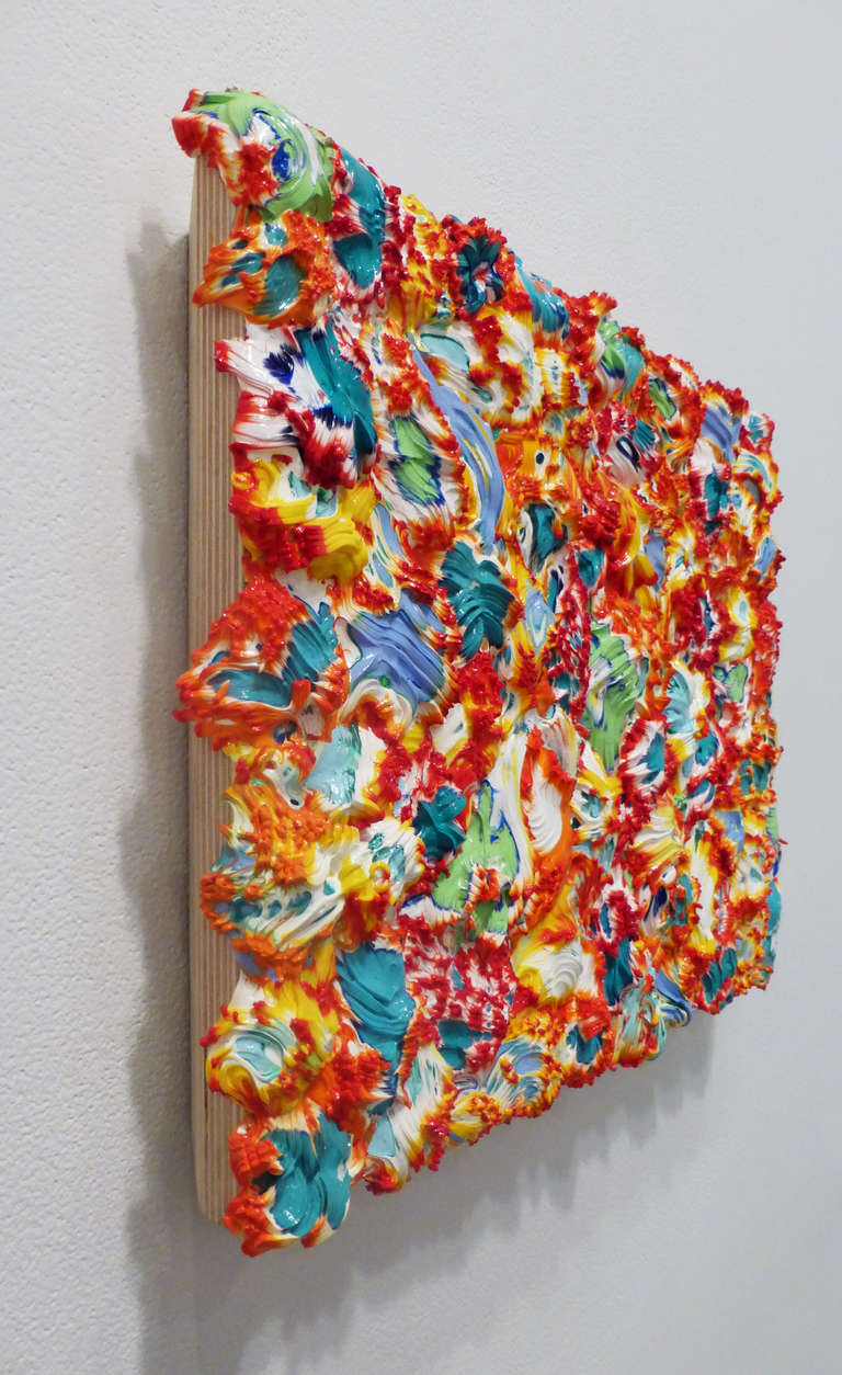 Vadim Katznelson's Over under is vivid with colors of red, blue, white, yellow, orange, green and teal.  Bursting out from their panel surface, Vadim Katznelson's work is colorfully dimensional. His sculptural paintings have been shown at