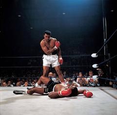 Muhammad Ali standing over a fallen Sonny Liston