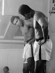 Muhammad Ali looking in the mirror while training at 5th Street Gym. Miami Beach