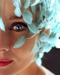 Audrey Hepburn with a light blue pillbox hat with bouncing feathers