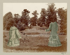 Two Headless young figures in a wooded landscape with a pond and promenade in th