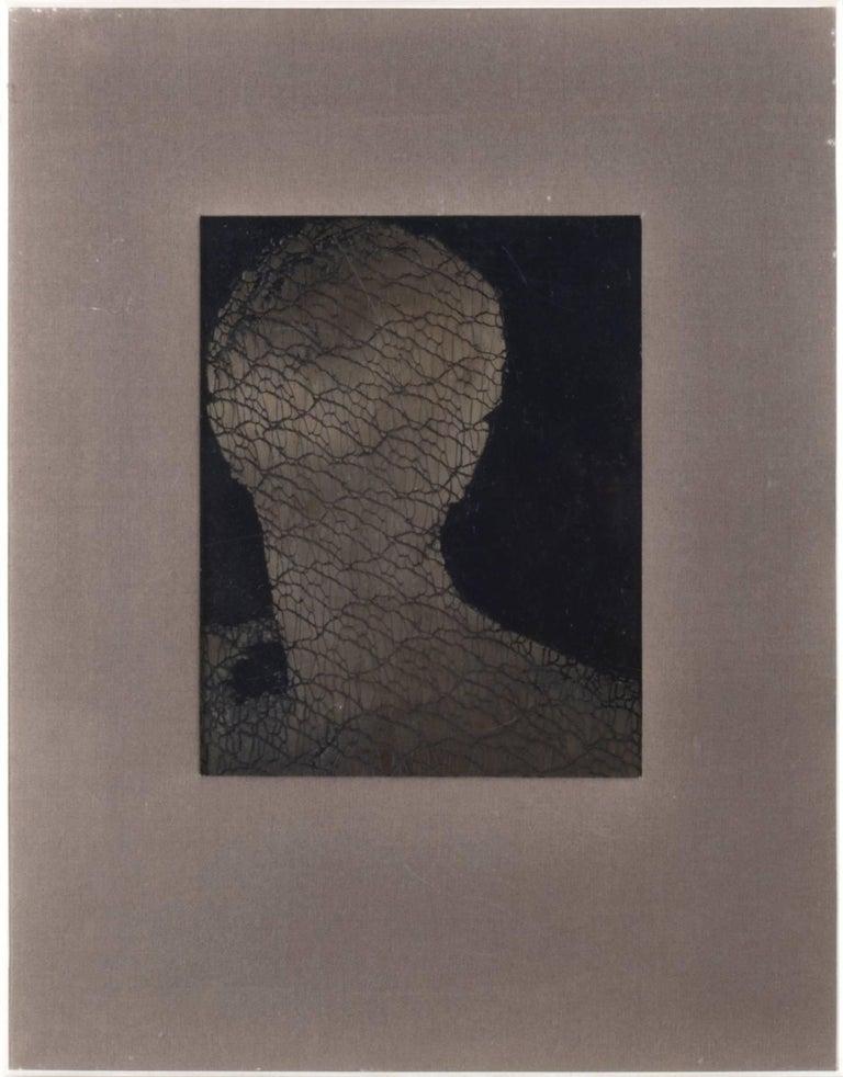 Naomi Savage Black and White Photograph - Enmeshed Man