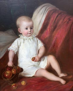 """Child holding Apple"""