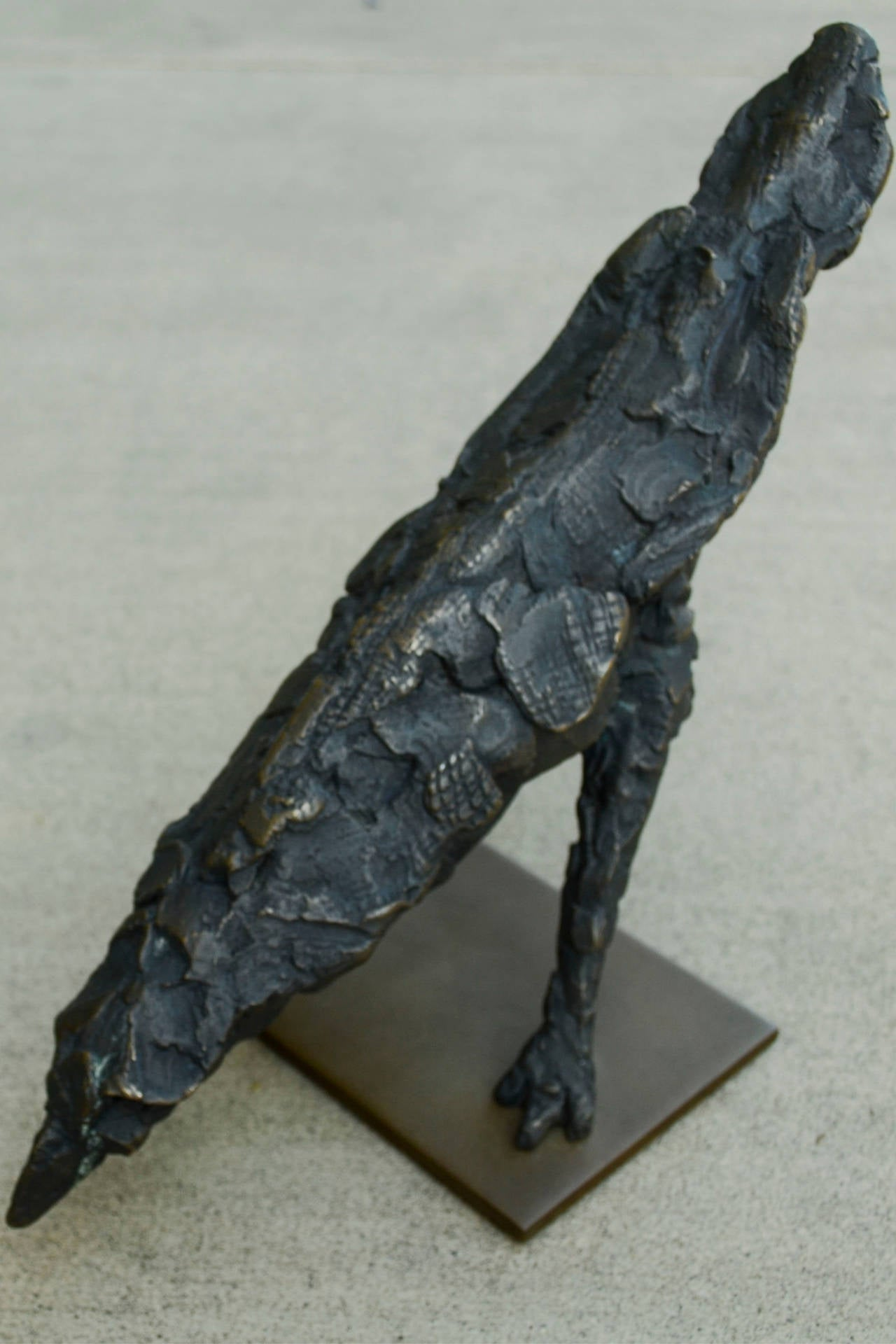 Cast bronze, Edition of 12  Named for the Roman god of agriculture; sixth planet from the sun; second largest planet.  Sharon Loper creates transitory sculptures out of bronze, stone, and wood and views her work as landscapes of thought based on