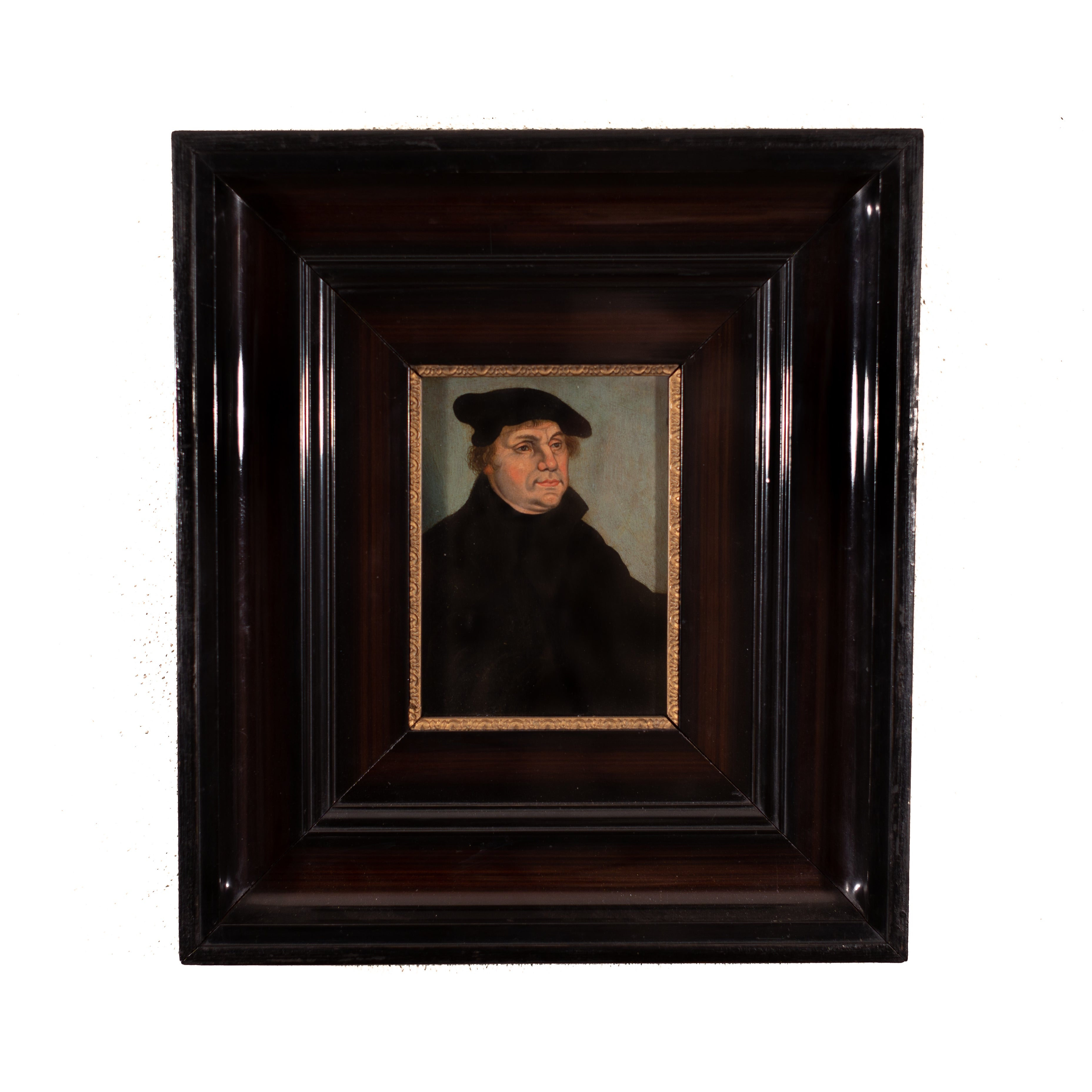 Portrait of Martin Luther by a Lucas Cranach the elder (follower), oil on panel