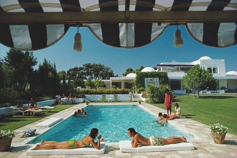 Slim Aarons 'Poolside at Sotogrande' (Slim Aarons Estate Edition) - Photograph by Slim Aarons