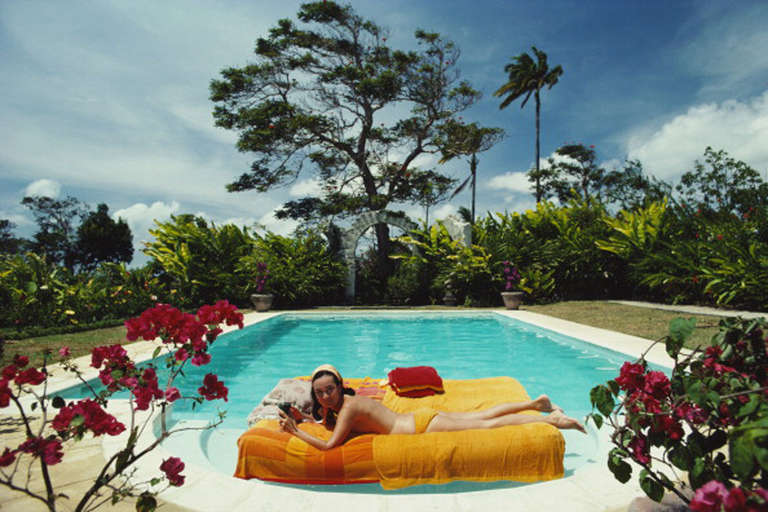 Slim Aarons Color Photograph Sunbathing In Barbados