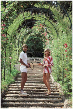 Jack and GeeGee Entz on Rose-Canopied Steps, Tivoli (Slim Aarons Estate Edition)