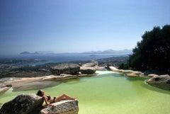 Slim Aarons 'Sunbather on Rock, Costa Smeralda Sardinia, Italy' (Estate Edition)