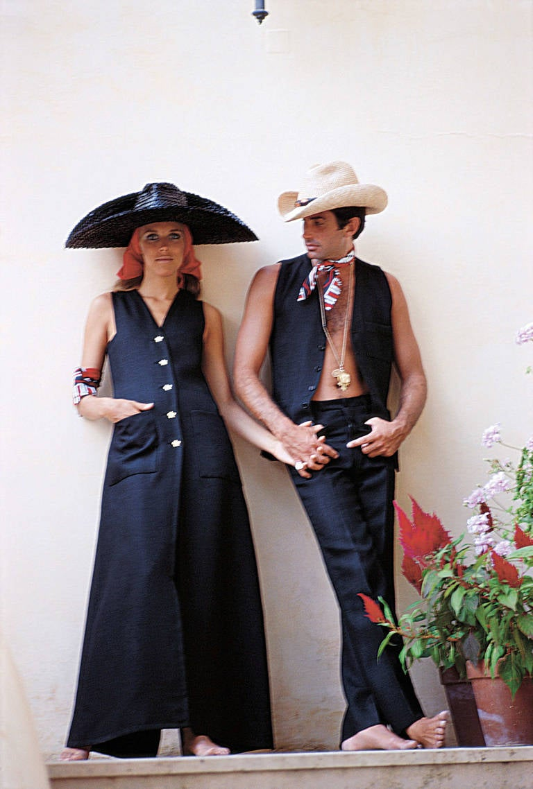Actor George Hamilton and model Alana Collins in Capri, Grand Hotel Quisisana.