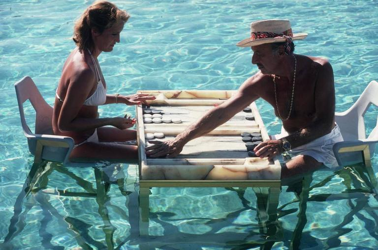 Slim Aarons Figurative Photograph - Keep Your Cool (Backgammon in Acapulco) free shipping