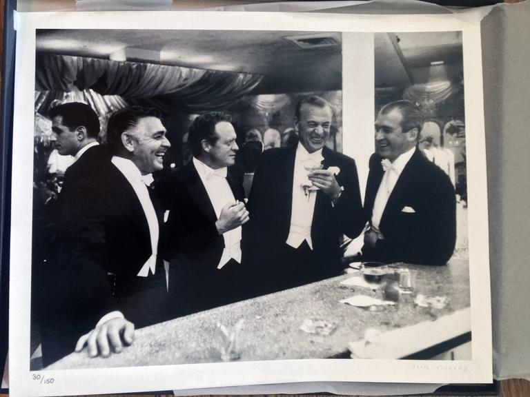 Kings of Hollywood (New Year's at Romanoff's) - Photograph by Slim Aarons