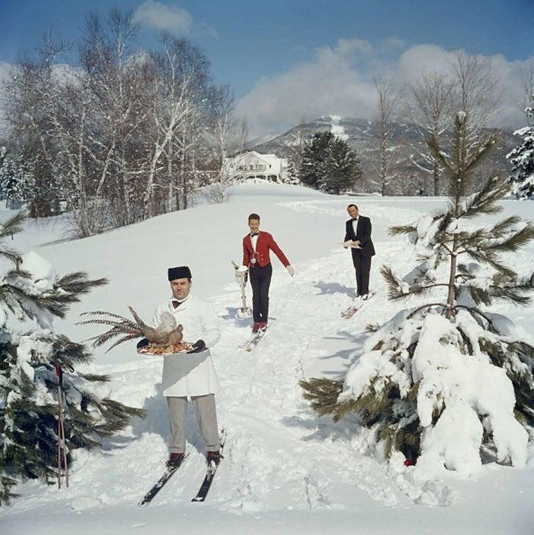 Slim Aarons 'Skiing Waiters' (Slim Aarons Estate Edition) - Photograph by Slim Aarons