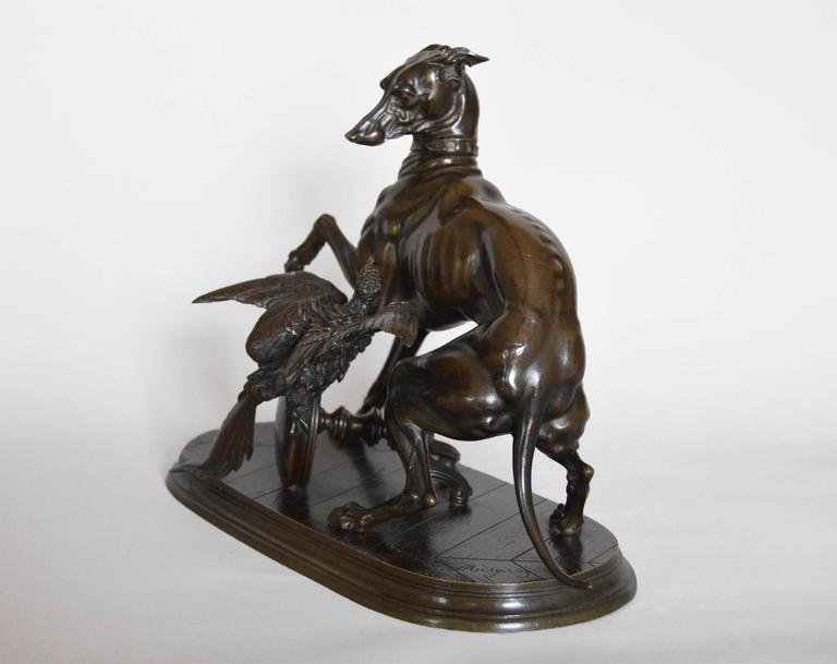 Jules Moigniez French, (1835-1894) Whippet & Macaw  Bronze, signed & incised 'Paul le Blanc 1068' to the underside Height: 8½ inches  Width: 10¾ inches Depth: 5 inches Provenance: Victor Franses Gallery, London  Jules Moigniez was a