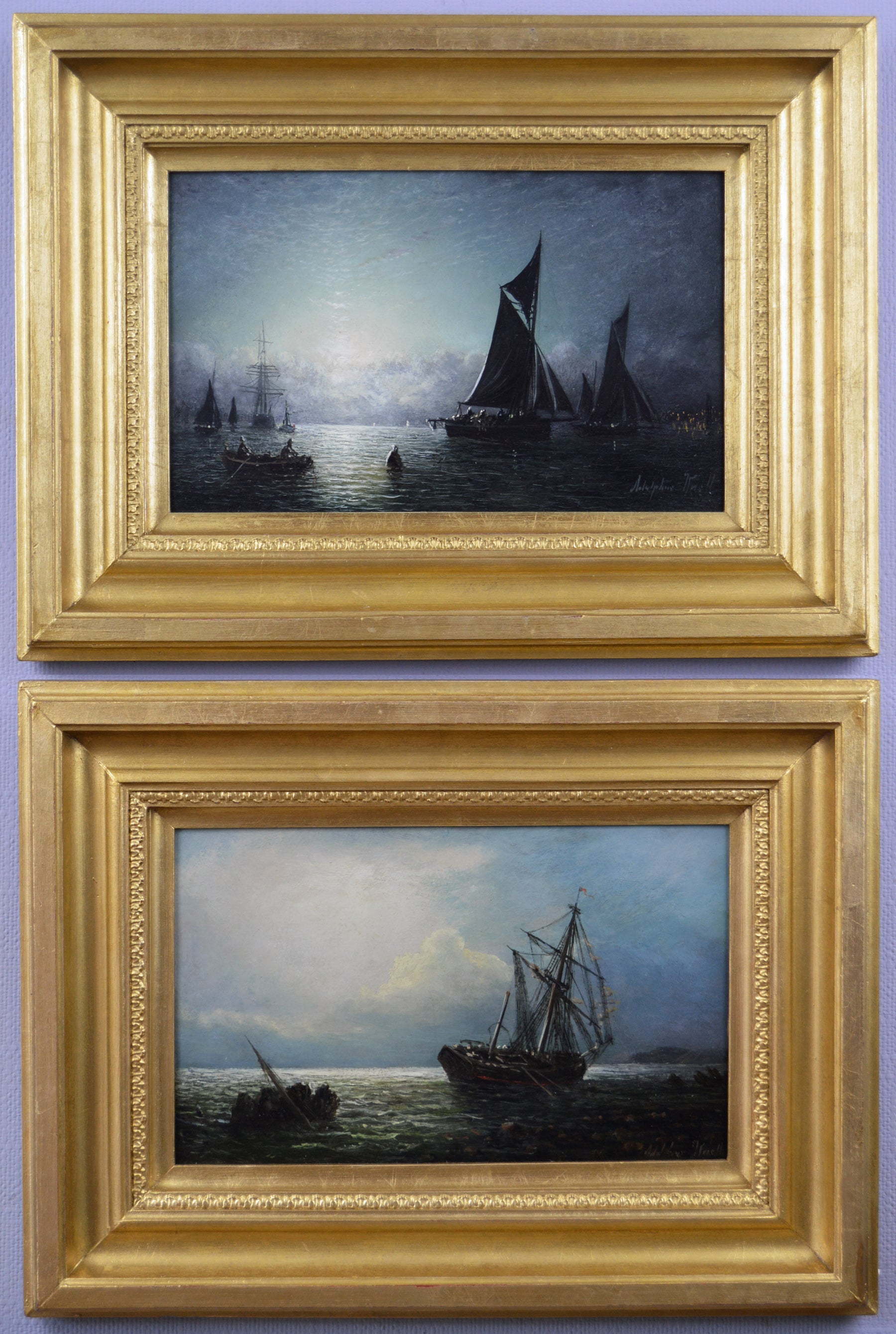 Pair of 19th Century moonlight seascape oil paintings of fishing boats