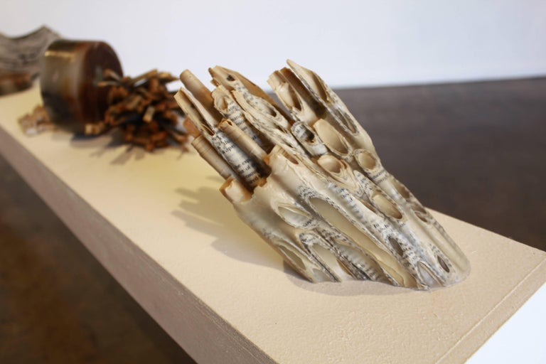 """Reading Our Remains series Carved Tubes Book, wax 9"""" x 4"""" x 5"""" H $650 Reading Our Remains is an ongoing collection of altered books, each piece inspired by nature and the ever-changing  natural world.  The collection began as an exploration in"""