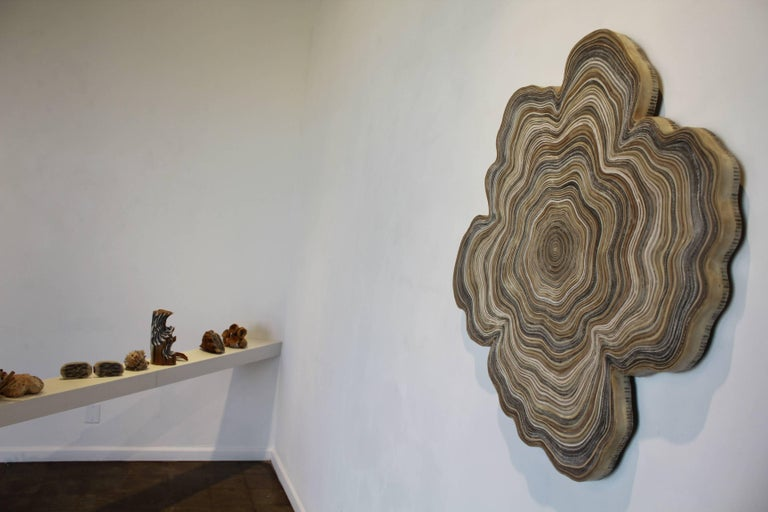 """Circulation 5 Book pages, wax 35"""" H x 34"""" W $10,000  In the Circulation series, coiled strips of book pages hint at the material connection between books and the wood pulp used to make them —a reminder of the circular life-cycle of materials and the"""