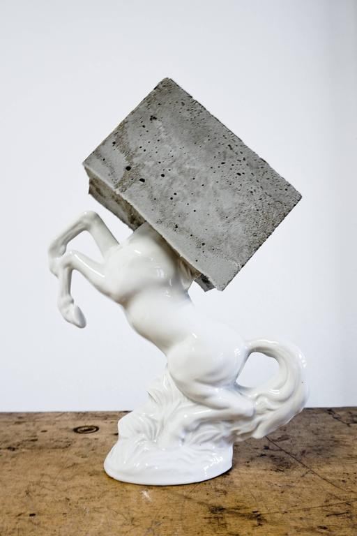 Becker Schmitz  Pegasus  Signed Sculpture Mixed media, porcelain stallion and concrete block 2017, signed. Unique  Dimensions: 30 x 24 x 12   In his paintings, Becker Schmitz creates hallucinatory pictures full of spectral beauty, pictures with