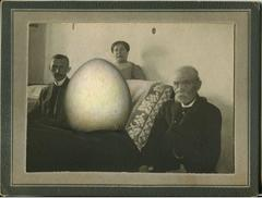 Untitled, Portrait of Three People Around Couch with Giant Egg