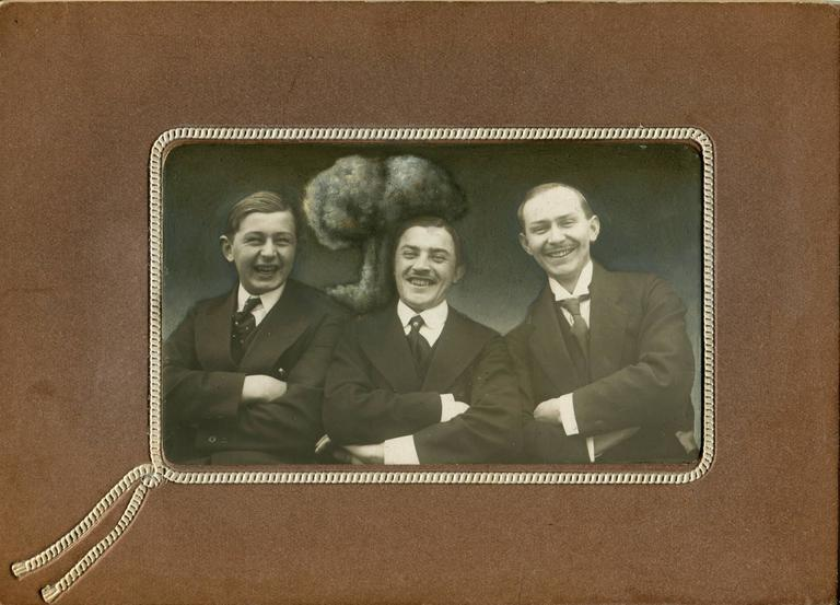 Untitled, Portrait of Three Man Smiling with Mushroom Cloud