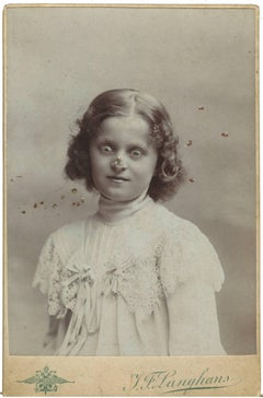Untitled (Girl crosseyed with bee on her nose)