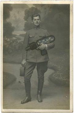 Untitled (Uniformed man with heart gun)