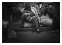 Migrant woman cradles her child in the Beijing Train Terminal, Landscape, China