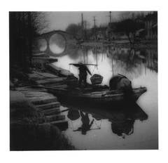 Unloading coal from a canal barge, near Suzhou, Jiangsu Province, China